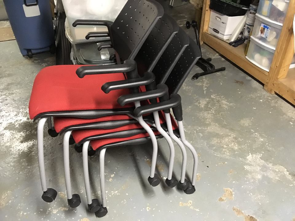 wheeled chairs stacked